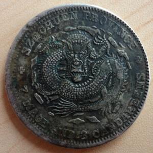 Szechuan dollar struck over a Sinkiang 1917 tael (obverse)