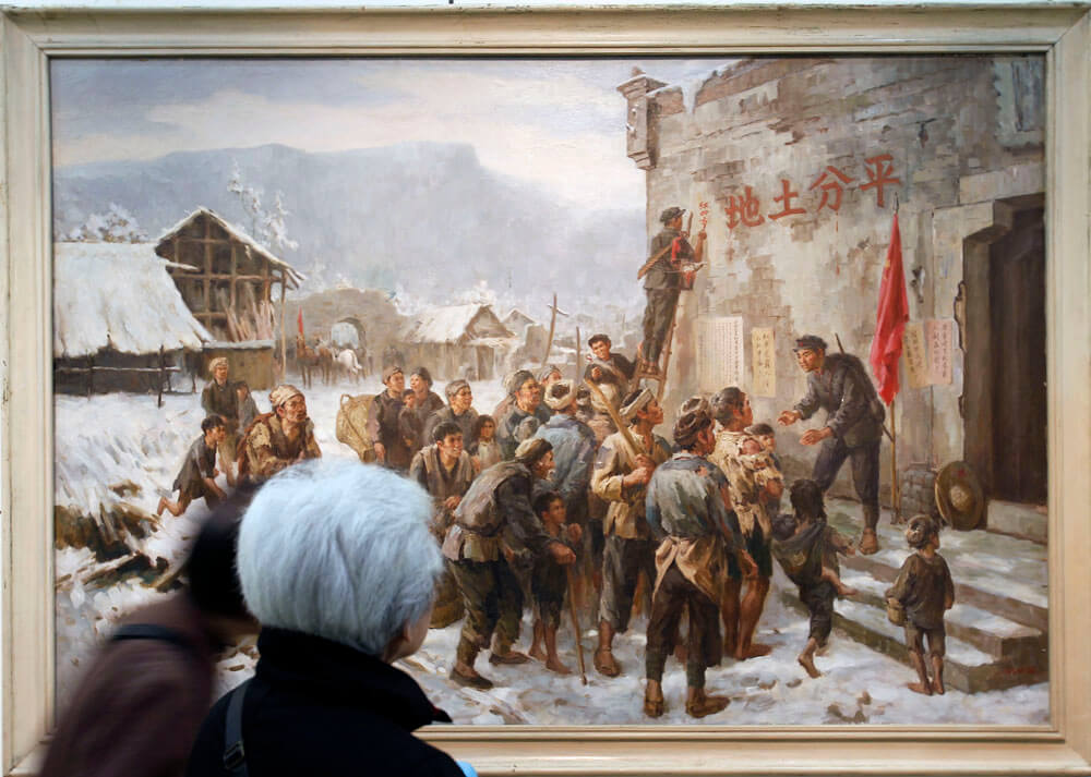 "A 92-year-old woman looks at ""The Red Army enters Northern Sichuan"", a 1957 painting from LIU Guoshu"